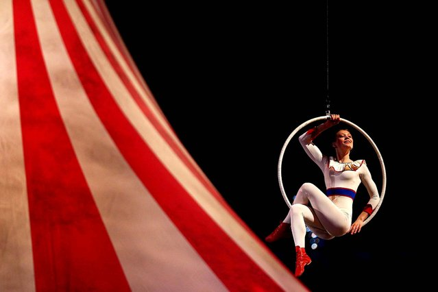 A circus performer participates in the closing ceremony. (Photo by Paul Gilham/Getty Images)