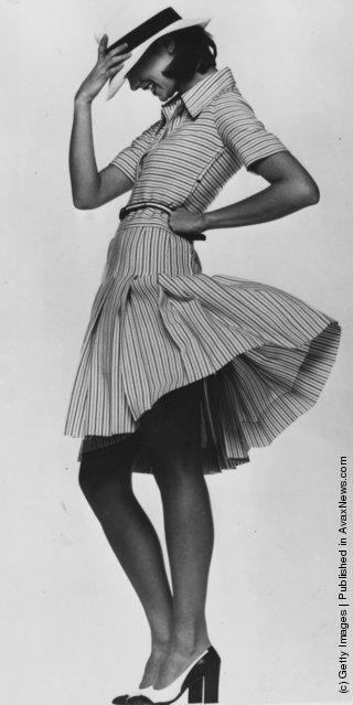 A black and white striped dress with a trilby style hat in the Spring and Summer Collection from Christian Dior, Paris