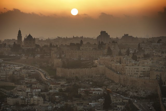 A partial view of the Old City of Jerusalem during sunset, on February 22, 2014. On the left the Christian Abbey of the Dormition. (Photo by Thomas Coex/AFP Photo)