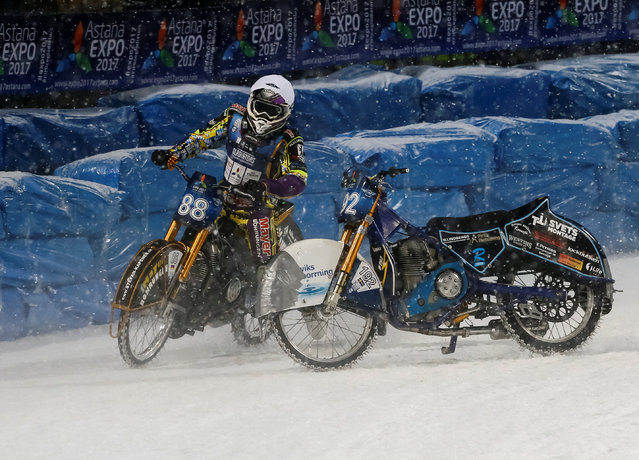 Max Niedermaier of Germany collides with uncontrolled motorcycle of Niclas Svensson of Sweden during Astana Expo FIM Ice Speedway Gladiators World Championship at the Medeo rink in Almaty, Kazakhstan, February 18, 2017. (Photo by Shamil Zhumatov/Reuters)