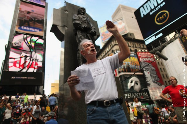 The day before the tenth anniversary of the September 11 attacks on New York and Washington, Christian preacher Terry Jones (C) lectures a crowd in Times Square