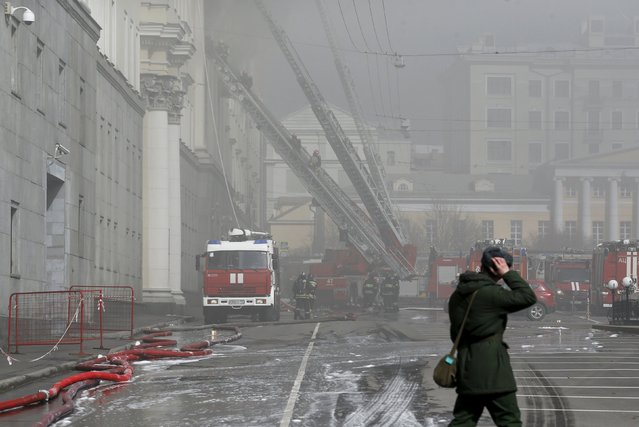 Firefighters work to extinguish a fire at the Russian Defence Ministry's building in central Moscow, Russia, April 3, 2016. (Photo by Maxim Zmeyev/Reuters)