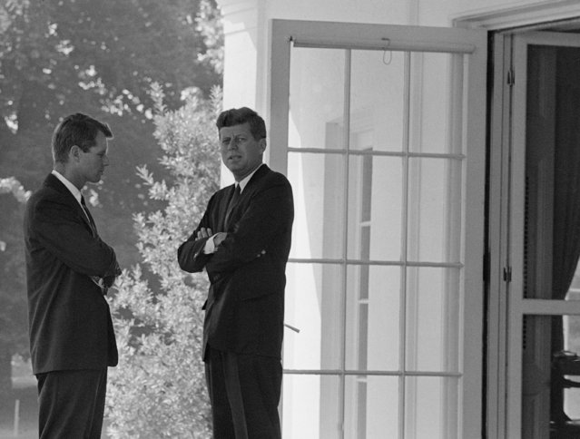 U.S. President John F. Kennedy, right, confers with his brother Attorney General Robert F. Kennedy at the White House in Washington, D.C., on October 1, 1962 during the buildup of military tensions between the U.S. and the Soviet Union that became Cuban missile crisis later that month. (Photo by AP Photo)