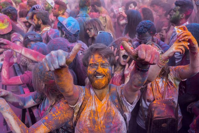 Revelers gesture as they take part in the color festival on May 17, 2015, in Istanbul. (Photo by Yasin Akgul/AFP Photo)