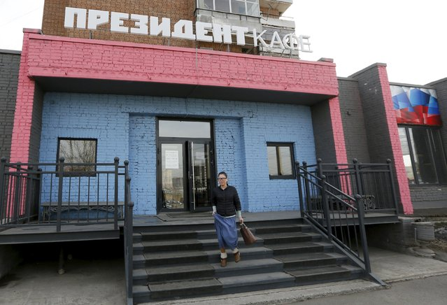 "A customer leaves the ""President Cafe"" in Krasnoyarsk, Siberia, Russia, April 7, 2016. (Photo by Ilya Naymushin/Reuters)"