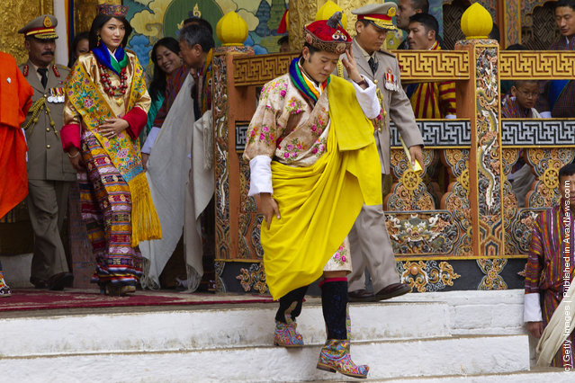 His majesty King Jigme Khesar Namgyel Wangchuck, 31, holds his Raven crown as he and the Queen Jetsun Pema, 21