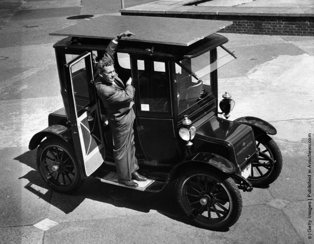 1960: The sun powered car, a 1912 Baker Electric Mode which has been adapted to run from energy obtained from the sun's rays. Dr. Charles Alexander  Escoffery, the car's inventor, explains the workings of the solar panel