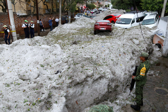 A general view of the damage due the accumulation of hail in the streets of Guadalajara, Jalisco, Mexico, 30 June 2019. A storm left a large amount of hail in the streets and according to Civil Protection and Fire, the hail entered some houses by the drainage. (Photo by Francisco Guasco/EPA/EFE)