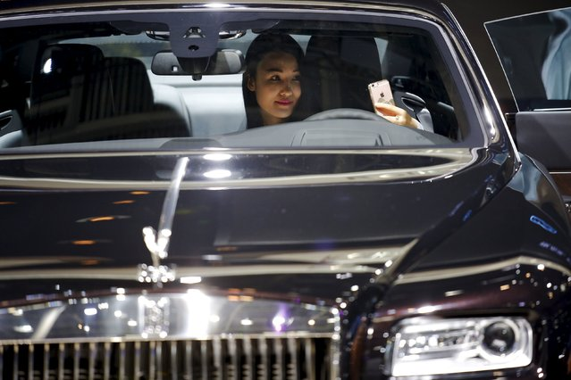 A visitor takes a selfie inside a Rolls-Royce presented during the Auto China 2016 auto show in Beijing April 25, 2016. (Photo by Damir Sagolj/Reuters)