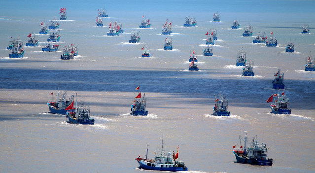 Fishing boats depart for fishing on August 1, 2019 in Zhoushan, Zhejiang Province of China. Over 3,000 fishing boats set sail for fishing after the three-month fishing ban on the East China Sea. (Photo by Hu Sheyou/VCG via Getty Images)