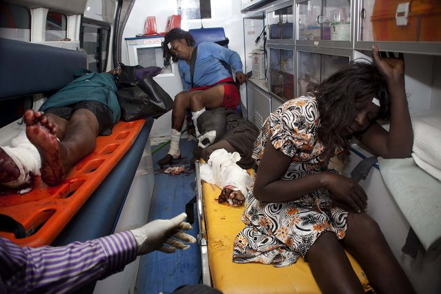 Injured people wait in an ambulance at Kenyatta National Hospital, Nairobi, on May 4, 2014. Two improvised explosive devices went off on buses along one of busiest highways in the Kenyan capital,  killing one person and wounding several others, as the East African nation struggles to crack down on a recent wave of terrorist attacks. (Photo by Sayyid Azim/Associated Press)