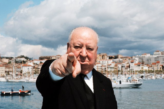British film director Alfred Hitchcock poses on a boat in Cannes, May 1972. Hitchcock directed his first film in 1925 and rose to become a master of suspense, internationally recognized for his intricate plots and novel camera technique. (Photo by AFP Photo/Getty Images)