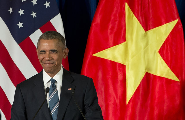 President Barack Obama winks as he arrives for a news conference with Vietnamese President Tran Dai Quang, Monday, May 23, 2016, at the International Convention Center in Hanoi, Vietnam. (Photo by Carolyn Kaster/AP Photo)