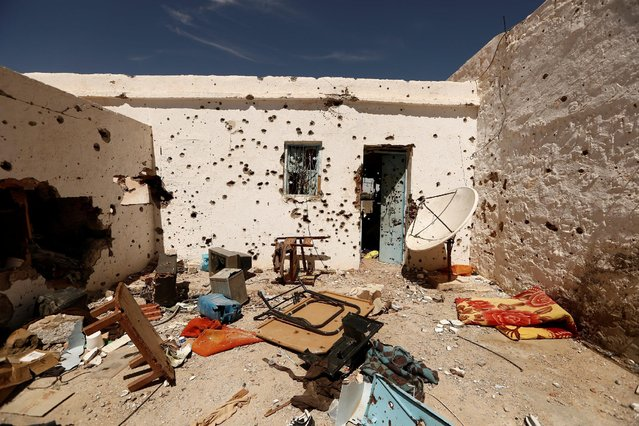 Household items lie on the ground at a house that was squatted by Islamic State jihadists and damaged during fighting with government forces in Ben Guerdane, near the Libyan border, Tunisia April 10, 2016. (Photo by Zohra Bensemra/Reuters)
