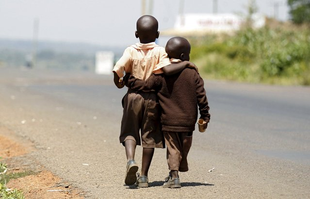 Boys walk home for lunch from school in the village of Kogelo, west of Kenya's capital Nairobi, July 16, 2015. (Photo by Thomas Mukoya/Reuters)