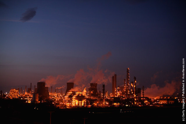 An illuminated Grangemouth Oil Refinery emits smoke in Grangemouth, Scotland