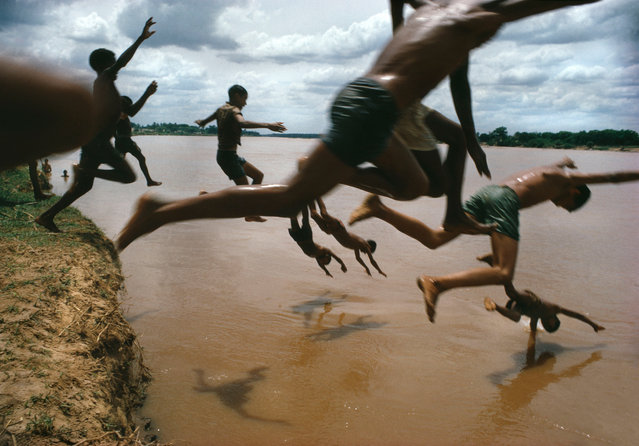 "Leticia, Amazonas, Brazil, 1966. The Amazon river. ""The decisive moment"" is a term coined by Henri Cartier-Bresson, the French pioneer who championed composed – rather than purely instinctive – photography. Magnum photographers were invited to select images that sum up the decisive moment for them, and share their thoughts. (Photo by Bruno Barbey/Magnum Photos)"