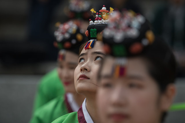 South Korean students attend a traditional coming-of-age ceremony at Namsan hanok village in Seoul on May 15, 2017. (Photo by Ed Jones/AFP Photo)