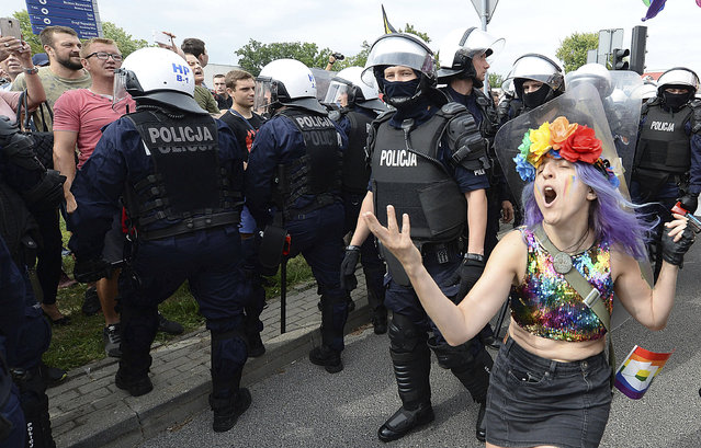 LGBT activists and their supporters gather for the first-ever pride parade in the central city of Plock, Poland, on Saturday August 10, 2019. The parade comes as the country finds itself bitterly divided over the growing visibility of the LGBT issue and as the government and powerful Catholic church denounce gay rights as a threat to society. (Photo by Czarek Sokolowski/AP Photo)