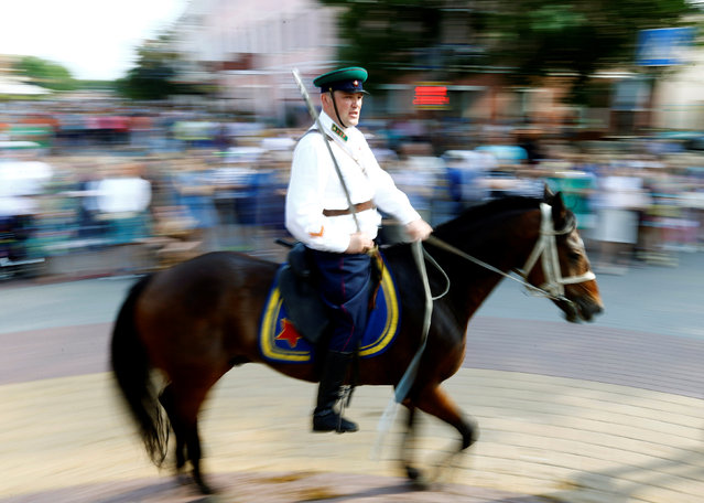 A military enthusiast dressed as World War Two Red Army soldier rides a horse as he marks the 75th anniversary of the Nazi Germany invasion, in Brest, Belarus June 21, 2016. (Photo by Vasily Fedosenko/Reuters)