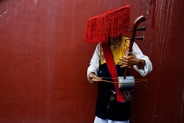 A Tibetan artists wearing a traditional costume waits before their performance during the 82nd pre-birthday celebration of Tibetan spiritual leader Dalai Lama at a Monastery in Kathmandu, Nepal, 05 July 2017. More than 1,000 monks and other Tibetans gathered at the Monastery compound to celebrate their spiritual leader's birthday. The Nepalese government has banned all kinds of Tibetan activities against the Chinese rule in Tibet so Tibetans have been changing the venue of the Dalai Lama's birthday celebration. The Dalai Lama will turn 82 on 06 July 2017. (Photo by Narendra Shrestha/EPA)