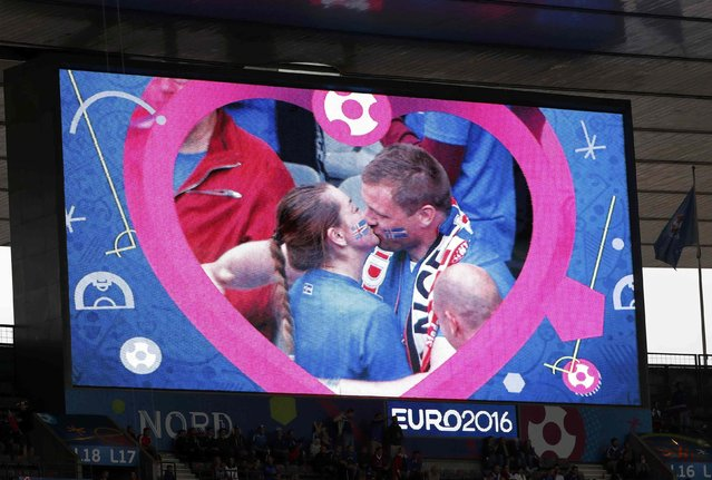 Football Soccer, France vs Iceland, EURO 2016, Quarter Final, Stade de France, Saint-Denis near Paris, France on July 3, 2016. Iceland fan after proposing to his girlfriend on the big screen before the match. (Photo by Charles Platiau/Reuters)