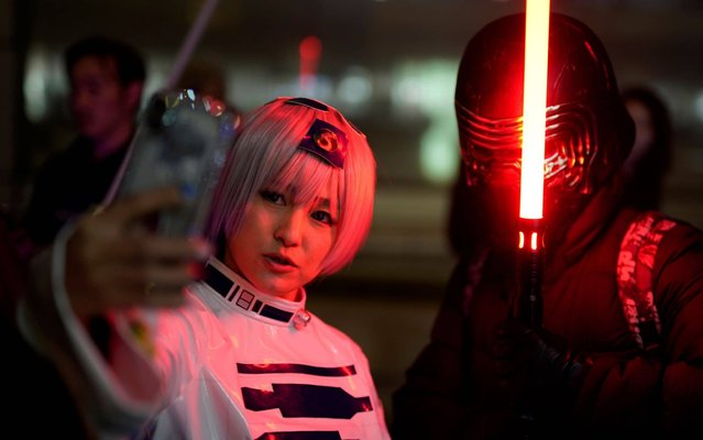 """Costumed Star Wars fans take a selfie before the first screening of """"Star Wars: Episode IX – The Rise of Skywalker"""" in Tokyo, Japan, 19 December 2019. The latest Star Wars saga movie will be released across Japan on 20 December 2019. (Photo by Franck Robichon/EPA/EFE/Rex Features/Shutterstock)"""