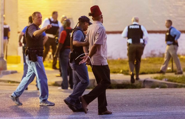 Police arrest a man as protesters gathered after a shooting incident in St. Louis, Missouri August 19, 2015. (Photo by Kenny Bahr/Reuters)
