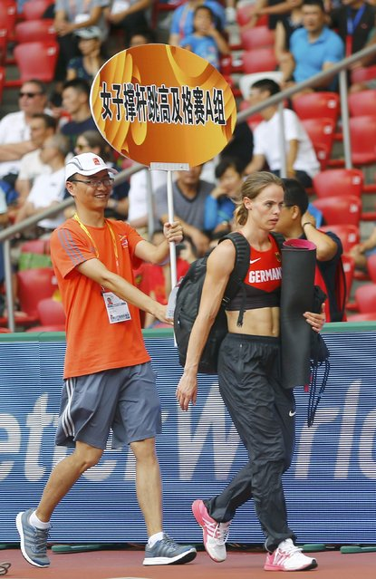 Silke Spiegelburg of Germany leaves the stadium after failing to get through to the next round in the women's pole vault qualification during the 15th IAAF World Championships at the National Stadium in Beijing, China August 24, 2015. (Photo by Kai Pfaffenbach/Reuters)