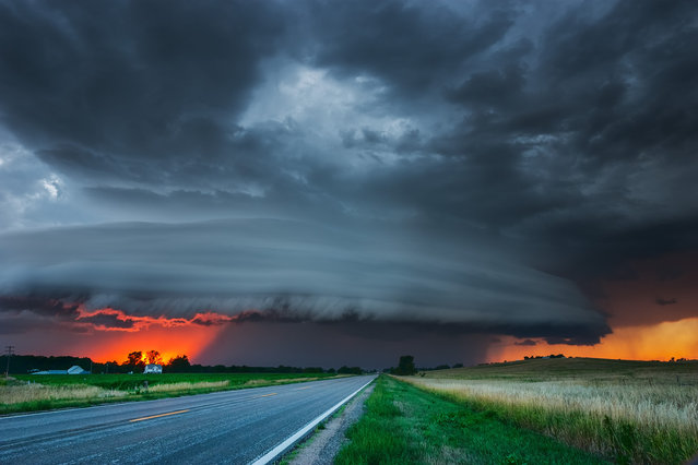 Vivid sunset under severe storm in central Nebraska August 17, 2005. (Photo by Mike Hollingshead)