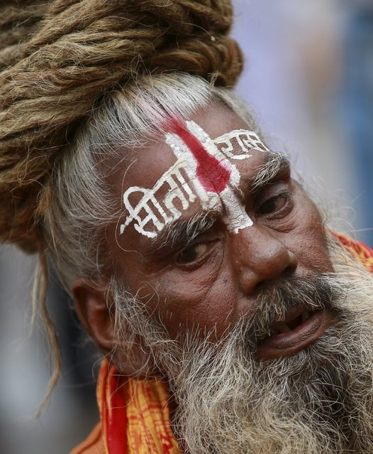 Sadhu, or a Hindu holy man, prays on the banks of Godavari river during Kumbh Mela or the Pitcher Festival in Nashik, India, August 26, 2015. (Photo by Danish Siddiqui/Reuters)