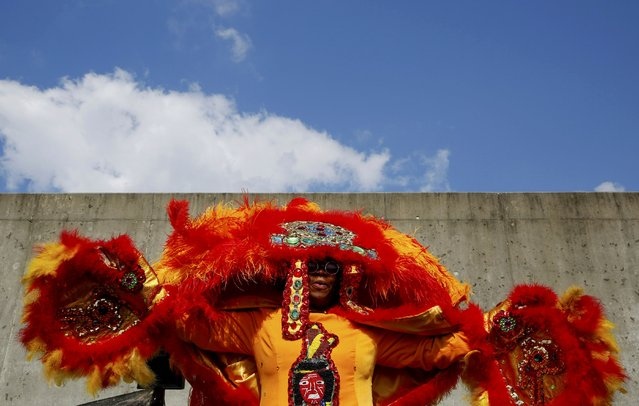 Mary Kay, 2nd Queen of the Wild Tchoupitoulas Mardi grass Indian Tribe, raises her arms along the Industrial Canal levee in the Lower 9th Ward at a ceremony marking the 10th Anniversary of Hurricane Katrina, in New Orleans, Louisiana, August 29, 2015. (Photo by Edmund D. Fountain/Reuters)