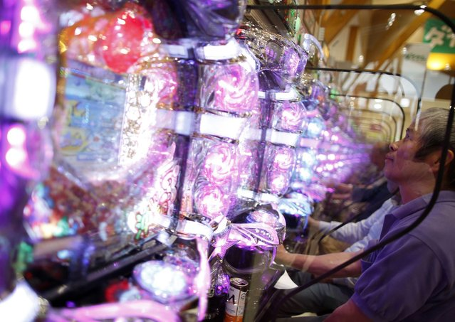 Visitors play at Dynam's pachinko parlour in Fuefuki, west of Tokyo June 19, 2014. (Photo by Issei Kato/Reuters)