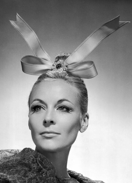 Famed French fashion designer Balenciaga created this eye catching head dress by placing a pink satin bow, ends up, on top of his models head and attaching it to a small chignon with a diamond – paved aster shown September 3, 1965. The diamond flower clip is by Van Cleef and Arpels. (Photo by AP Photo)