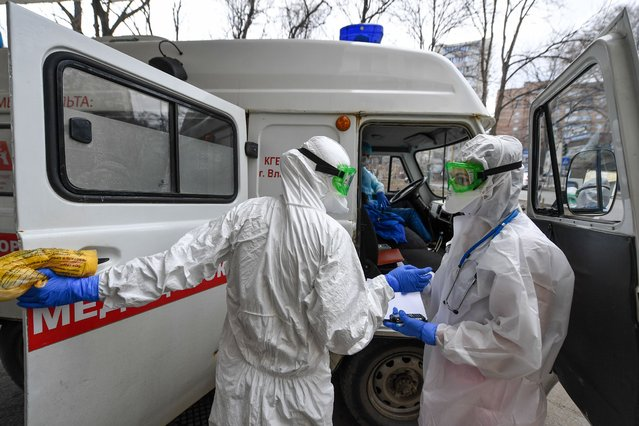 Emergency paramedics ahead of a house call at the Vladivostok medical emergency service in Vladivostok, Russia on April 23, 2020 during the ongoing COVID-19 coronavirus pandemic. (Photo Yuri Smityuk/TASS)