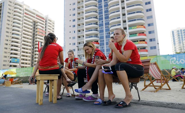 Athletes from Montenegro gather inside the Olympic Village in Rio de Janeiro, Brazil August 1, 2016. (Photo by Kai Pfaffenbach/Reuters)
