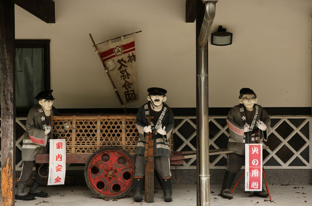 An illustration showing scarecrows dressed in traditional Japanese firemen costumes are on display outside of abandoned building at Kakashi no Sato, or the Scarecrow's Hometown on September 10, 2014 in Himeji, Japan. (Photo by Buddhika Weerasinghe/Getty Images)