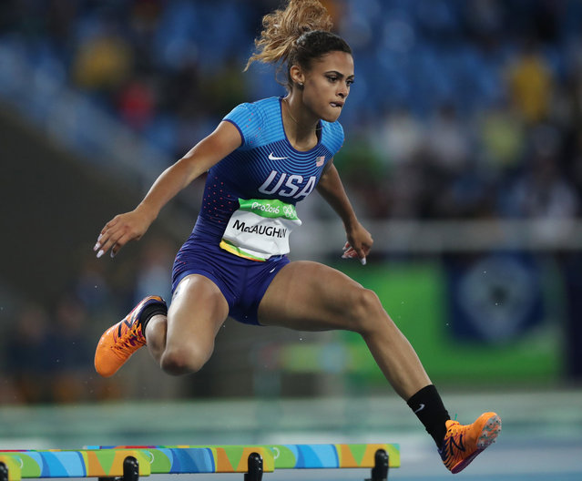 United States' Sydney McLaughlin competes in a women's 400-meter hurdles heat during the athletics competitions of the 2016 Summer Olympics at the Olympic stadium in Rio de Janeiro, Brazil, Monday, August 15, 2016. (Photo by Lee Jin-man/AP Photo)