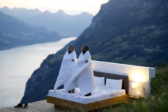 Swiss artists Frank and Patrik Riklin pose in the bedroom of their Zero-Real-Estate land art installation, as the outbreak of the coronavirus disease (COVID-19) continues, on an alp in front of the Churfirsten mountain range and Lake Walen near Walenstadt, Switzerland May 29, 2020. (Photo by Arnd Wiegmann/Reuters)