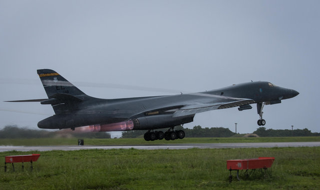 In this photo released by the U.S. Air Force, an U.S. Air Force B-1B Lancer bomber assigned to the 37th Expeditionary Bomb Squadron, deployed from Ellsworth Air Force Base, South Dakota, takes off from Andersen Air Force Base, Guam, to fly a mission with two Koku Jieitai (Japan Air Self-Defense Force) F-15s, September 9, 2017. (Photo by Senior Airman Jacob Skovo/U.S. Air Force via AP Photo)