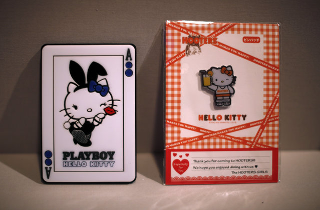 """Cards depicting Hello Kitty as a Playboy bunny and a Hooters Girl are seen at the """"Hello! Exploring the Supercute World of Hello Kitty"""" museum exhibit in honor of Hello Kitty's 40th anniversary, at the Japanese American National Museum in Los Angeles, California October 10, 2014. (Photo by Lucy Nicholson/Reuters)"""