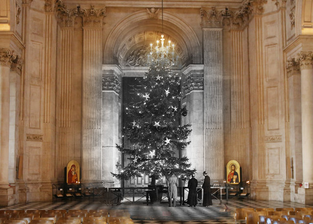 Archive: The Christmas tree in St Paul's Cathedral, London, which was brought from the royal estates at Windsor on December 19, 1950 in London, England.  (Photo by Fox Photos/Getty Images) Modern Day: St Paul's Cathedral prepares for Christmas on December 9, 2014 in London, England. Christmas is an annual religious feast day originally set on December 25 to celebrate the birth of Jesus Christ and is a cultural festival and public holiday celebrated by billions of people around the world. (Photo by Peter Macdiarmid/Getty Images)
