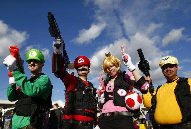 A group disguised as Super Mario Brothers characters pose outside the MCM Comic Con at the Excel Centre in East London, October 25, 2014. (Photo by Andrew Winning/Reuters)