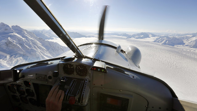Snow-covered mountains and glaciers are seen during a flight over the Kluane National Park and Reserve in southwestern Yukon Territory, October 7, 2014. (Photo by Bob Strong/Reuters)