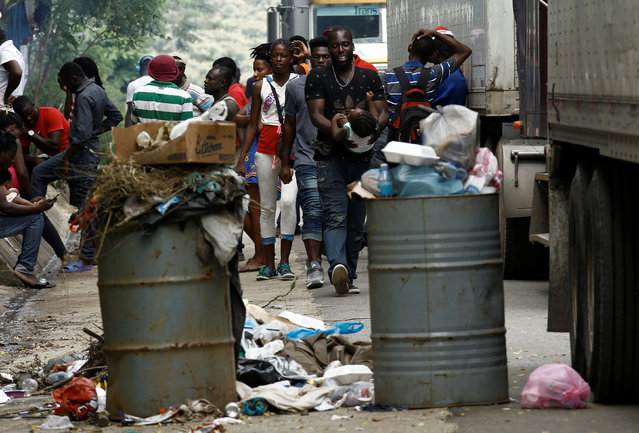 African migrants stranded in Costa Rica walk near garbage on the Inter-American highway at the border between Costa Rica and Nicaragua, in Penas Blancas, Costa Rica, September 8, 2016. (Photo by Juan Carlos Ulate/Reuters)