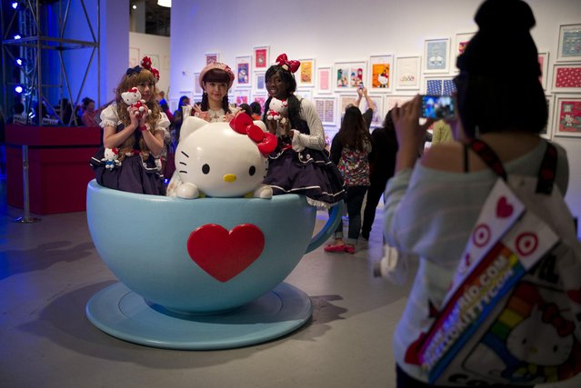 Hello Kitty fans pose for photos in a giant tea cup at the Hello Kitty Con, the first-ever Hello Kitty fan convention, held at the Geffen Contemporary at MOCA Thursday, October 30, 2014, in Los Angeles. (Photo by Jae C. Hong/AP Photo)