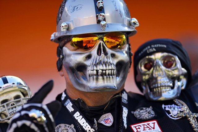 Oakland Raiders fan James Godley watches his team warm up before an NFL football game against the Cleveland Browns Sunday, October 26, 2014, in Cleveland. (Photo by Tony Dejak/AP Photo)