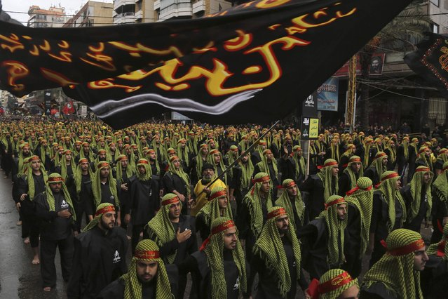 Lebanese Hezbollah supporters march during a religious procession to mark Ashoura in Beirut's suburbs November 4, 2014. (Photo by Aziz Taher/Reuters)