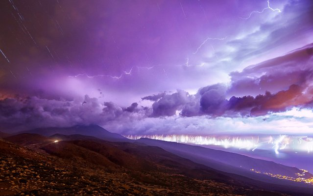 A handout photo made available by TeideLab shows an image composed of 200 pictures that shows the lightning activity between 3 am and 7am during a storm in Izana, Tenerife, Canary Islands, Spain, 27 October 2019. Over 2,000 lighting strikes fell mostly over Tenerife island last 26 October during a strong storm. (Photo by Daniel López/EPA/EFE/TeideLab)