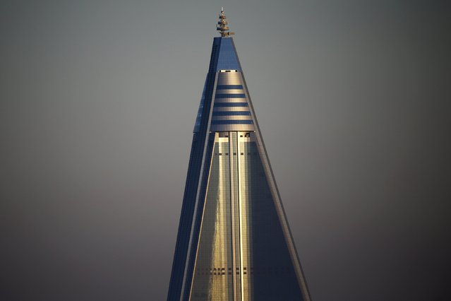 The top of the 105-storey Ryugyong Hotel, the highest building under construction in North Korea, is seen in Pyongyang, North Korea early October 9, 2015. (Photo by Damir Sagolj/Reuters)